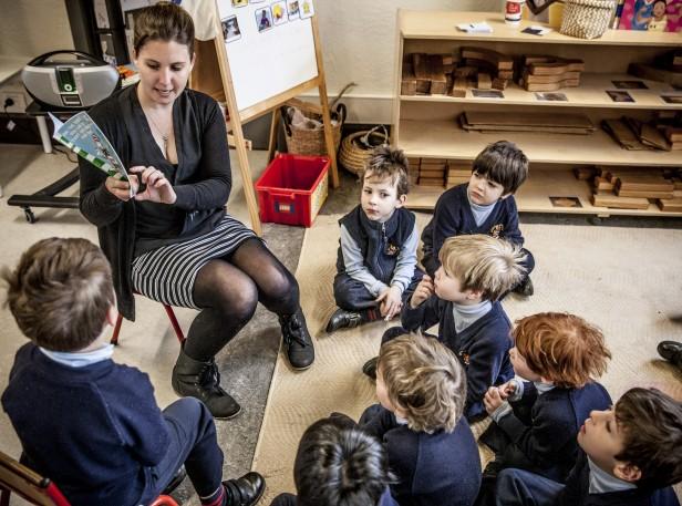 Teacher reads to Brighton grammar ELC boys